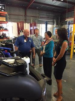 Senator Hirono and Chamber of Commerce Hawaiʻi President Sherry Menor-McNamara are briefed on hydrogen fuel cells by HCATT Director Stan Osserman. Courtesy photo.
