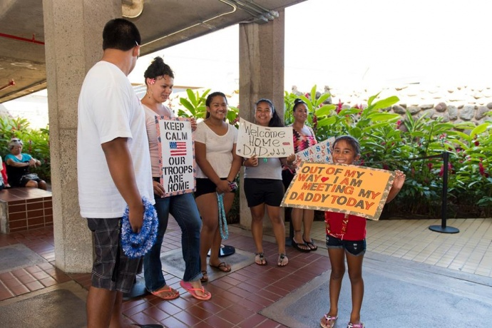 Mayor Alan Arakawa and Managing Director Keith Regan were on hand to welcome back 17 Hawaii Air National Guardsmen from the 292nd Combat Communication Squadron from a six-month deployment in the Mideast. (Photos: Ryan Piros) (7.28.2015)