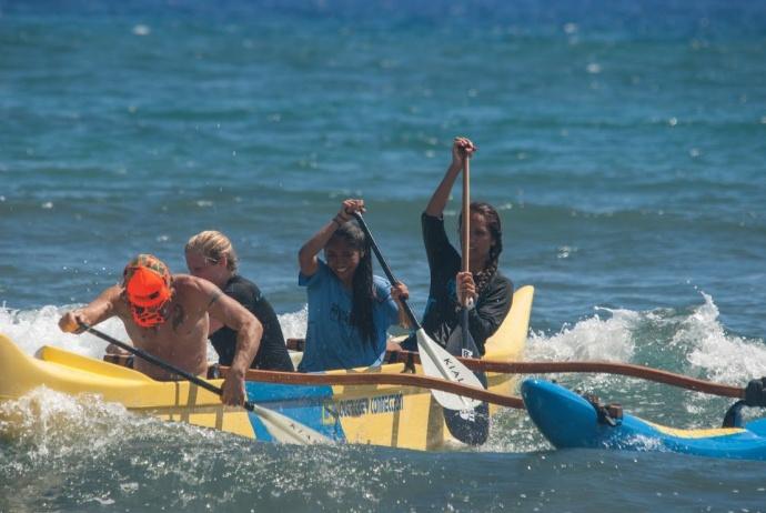 Hawaiian Paddle Sports Instructor Mikey Leet, MYFS youth Breanna Racoma and Precious Rayray, and HPS Instructor Rowdey Lindsey