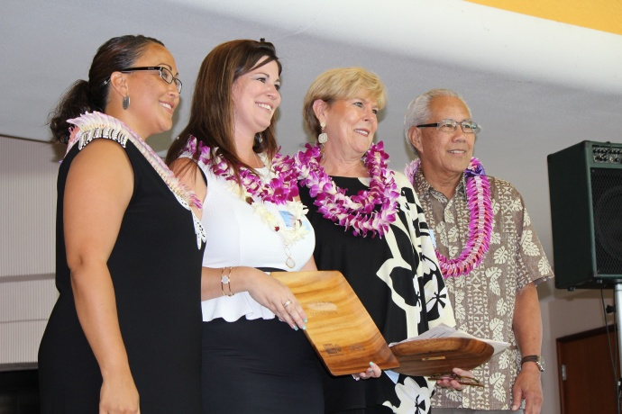 Deanna Davis and Sandra Florence received co-volunteer of the Year honors at the 46th Annual MUW Meeting and Recognition Luncheon for their role in spearheading the Shelter Renewal Project for Women Helping Women. Photo by Wendy Osher. (July 2, 2015)