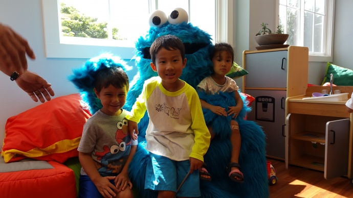(LtoR) Zyler, Caden and Cara sit with Cookie Monster