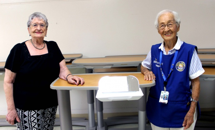 Amy Hanlon and Yoshie Ito display one of the new tables.  Photo credit: Maui Memorial Medical Center.