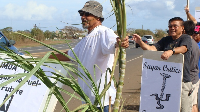 """If those people complain about burning cane–if they can support 800 workers–then they have a right to speak; but my point is who are they to say how to run the lifestyle of the island,"" said Charles Jennings, HC&S retiree (front left) during a demonstration backing HC&S's lifestyle and jobs in Sept. 2012. File photo by Wendy Osher."