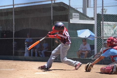 Zach Dando hitting. Photo credit: Ashley Dando.