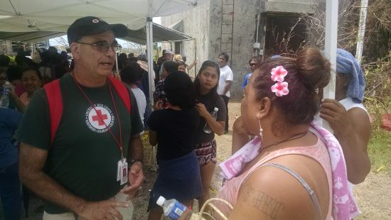 4 Red Cross volunteer Lee Gramas, of Glen Ellyn, Illinois, meets with affected residents at the Red Cross assistance center on Saipan