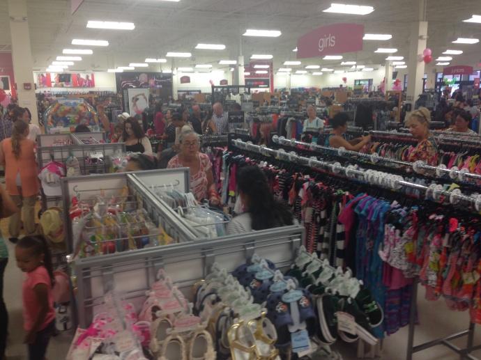 Shoppers puruse T.J. Maxx merchandise