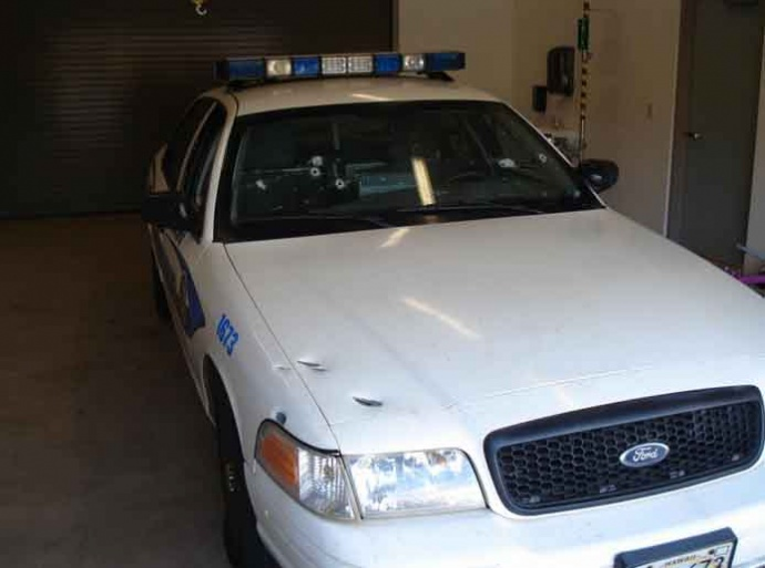 Front passenger side view of the patrol vehicle depicting damages of the hood and fender. Photo credit Maui police.