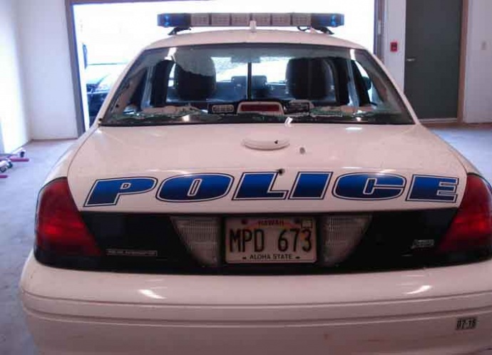 Rear view of the patrol vehicle depicting damages to the trunk and rear view window. Photo credit: Maui police.