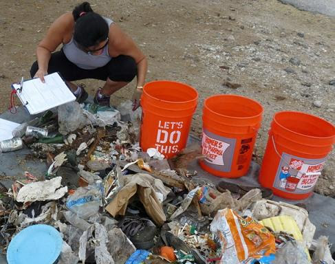 olunteer sorts trash at a Keep Puako Beautiful cleanup. Photo courtesy of Keep Puako Beautiful.