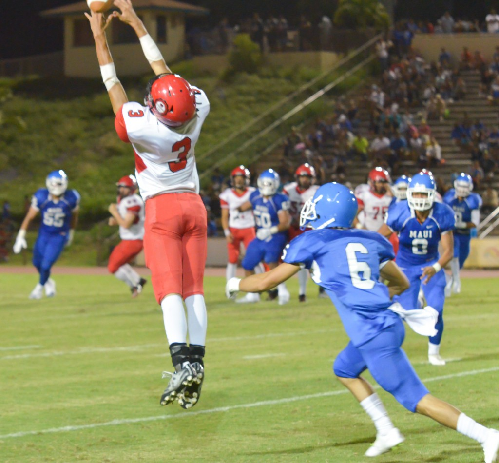 Lahainaluna's Kiakahai Kenolio (3) goes up for pass as Maui High;s Nathan Vierra defends. Photo by Rodney S. Yap.