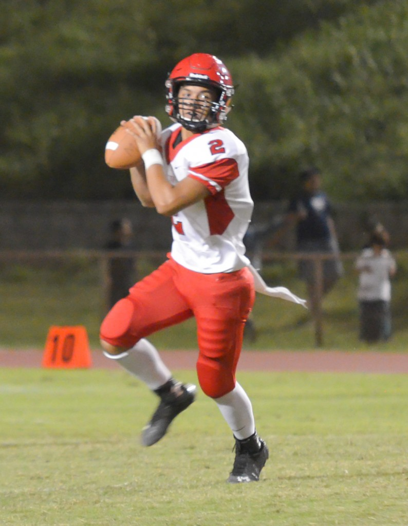 Lahainaluna's Etuati Storer rolls out for a pass attempt. Photo by Rodney S. Yap.