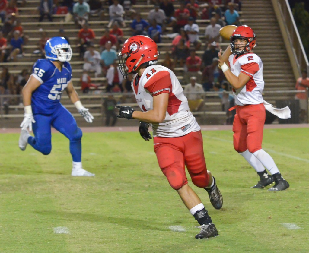 Lahainaluna quarterback Etuati Storer (2) tries to hit running back Justice Tihada (11) on this flare pass attempt. Photo by Rodney S. Yap.