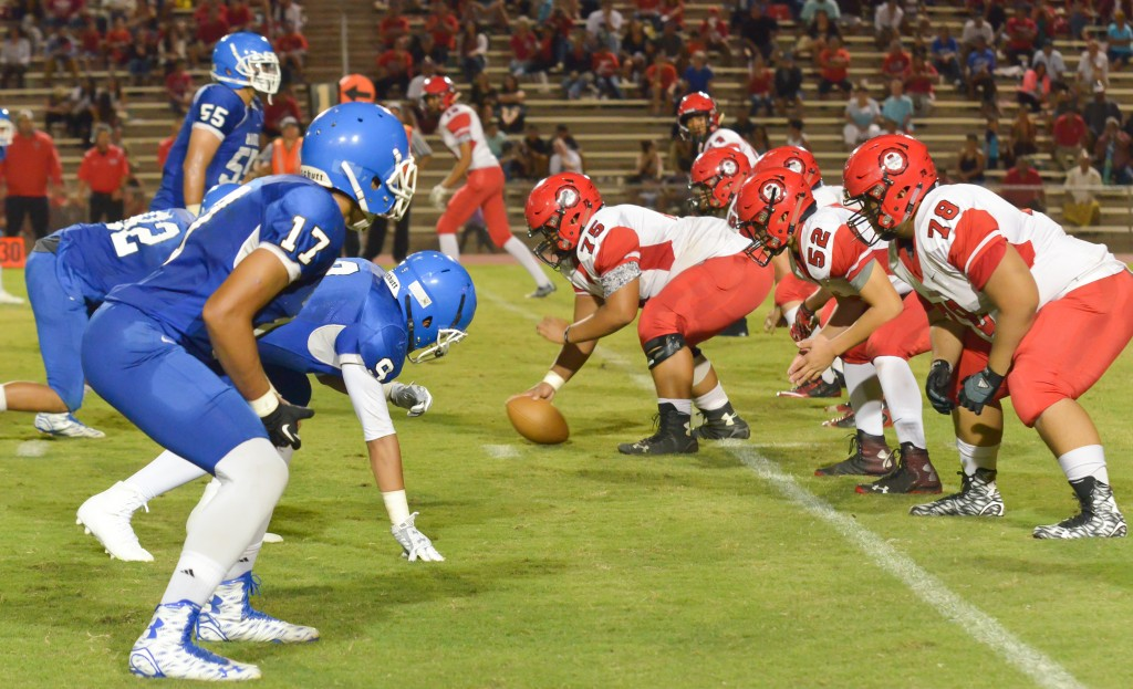 Lahainaluna's offense lines up against Maui High's defense Friday in the second half. Photo by Rodney S. Yap.