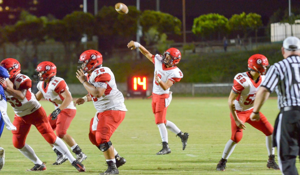 Lahainaluna quarterback Etuati Storer (2) throws a pass attempt into the end zone. The pass was broken up by Maui High's Nathan Vierra. Photo by Rodney S. Yap.
