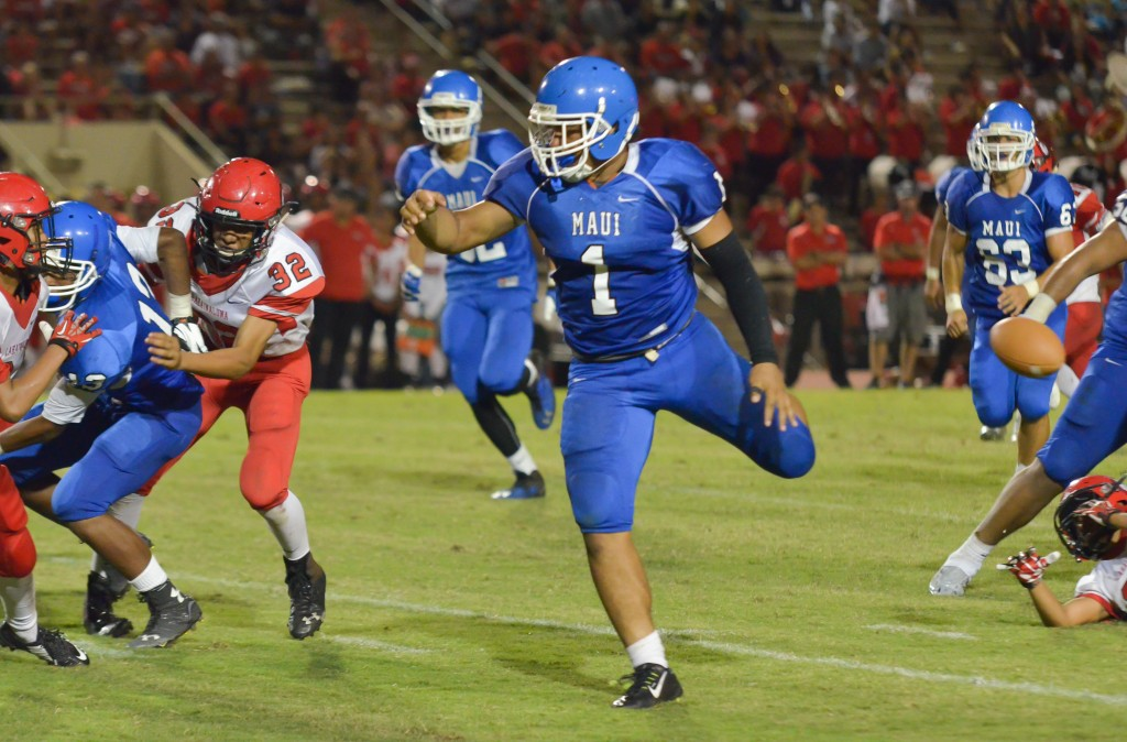 Maui High's Soane Vaohea (1) fumbles the ball as he's running Friday against Lahainaluna. Photo by Rodney S. Yap.
