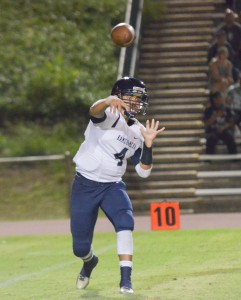 Kamehameha Maui quarterback Kainoa Sanchez throws a flat pass in the first half Saturday. Photo by Rodney S. Yap.