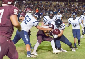 Baldwin quarterback Chayce Akaka (12) runs the ball against Kamehameha Maui Saturday. Photo by Rodney S. Yap.