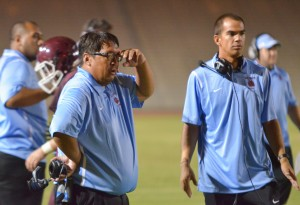 Baldwin head coach Pohai Lee (left) and receivers' coach Colten Quinabo watched the Bears' offense score via the pass four times Saturday against Kamehameha Maui. Photo by Rodney S. Yap.