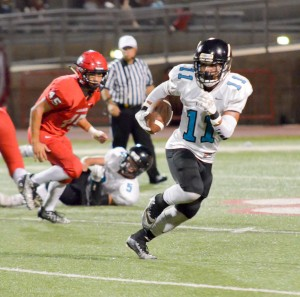 King Kekaulike's Kawika Akahi finds running room in the first half against Lahainaluna. Photo by Rodney S. Yap.