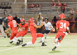 Lahainaluna's Siale Hafoka (15) can't control the ball to haul in this would-be interception. Photo by Rodney S. Yap.