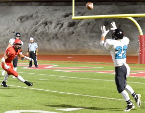 King Kekaulike's Brandon Soriano (22) awaits this pass from quarterback Cameron Russell (5). Photo by Rodney S. Yap.