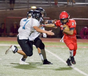 Lahainaluna's Elijah Ragudo tries to escape the grasp of a pair of King Kekaulike defenders. Photo by Rodney S. Yap.