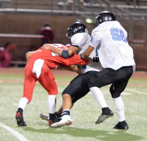 King Kekaulike's defense makes a play behind the line of scrimmage against Lahainaluna Saturday. Photo by Rodney S. Yap.