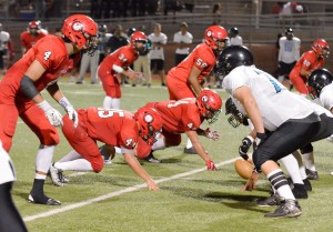 Lahainaluna's defense lines up against Kekaulike's offense. Photo by Rodney S. Yap.
