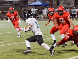 King Kekaulike's Kawika Akahi (11) finds an opening in the Lunas' defense. Akahi scored his team's only touchdown on this 75-yard run in the third quarter. Photo by Rodney S. Yap.
