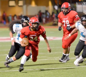 Lahainaluna's Radon Sinenci weaves his way through the Kekaulike defense en route to one of his two touchdown runs. Photo by Rodney S. Yap.