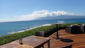 View of Pacific Ocean from outdoor patio at Merriman's Kapalua. Photo by Kiaora Bohlool.