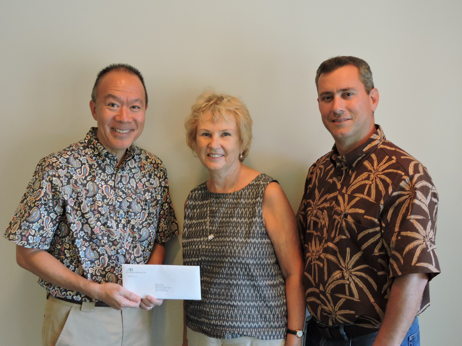 "Susana Browne of MACC with Grant Y.M. Chun (A&B Properties) left, and Rick Volner, Jr. (HC&S). Alexander & Baldwin has given $10,000 to support Maui Arts & Cultural Center's ""CanDo! Days"" - a well-known and much-loved facet of The MACC's overall arts education program. Arts education at The MACC extends the learning potential of more than 10,000 Maui County students annually."