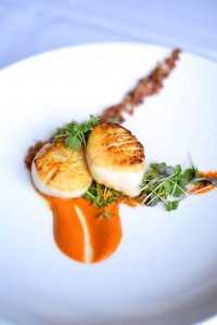 Pan-seared New Bedford scallops w/ paquillo pepper romesco & applewood- smoked bacon. Photo courtesy of Fleetwood's on Front Street.