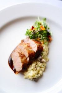 Citrus-marinated pork loin over mascarpone risotto with English peas & morel mushrooms. Photo courtesy of Fleetwood's on Front Street.