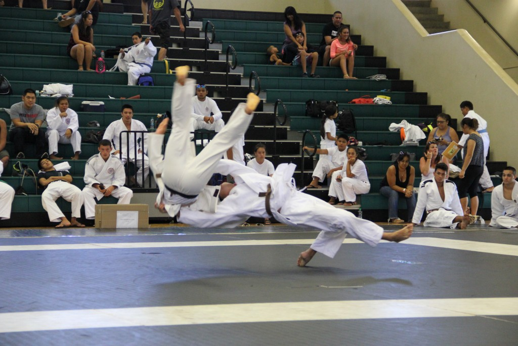Aaron Yoshizu of Makawao Hongwanji throws Miyuki Patricio of Makawao Hongwanji using Ura Nage in the Nage No Kata Division 2. Photo credit: Cy Yoshizu.