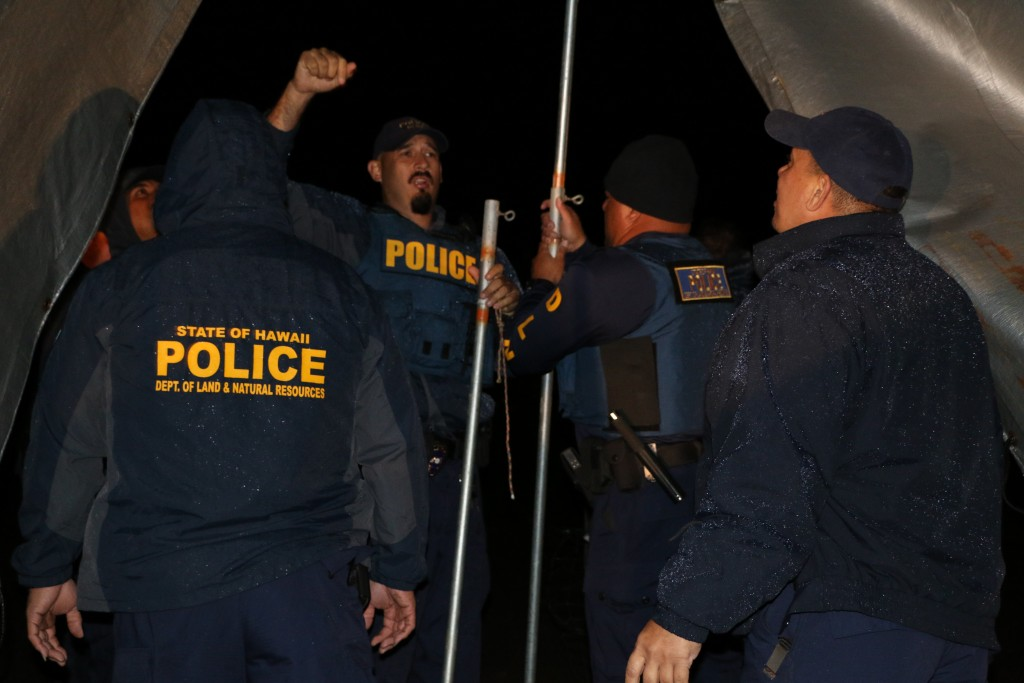 DOCARE officers disassembed, loaded and took as evidence, a large tent that protesters had erected at the 9000 foot elevation level, across the road from the Mauna Kea Visitors Center. Photo credit: DLNR.