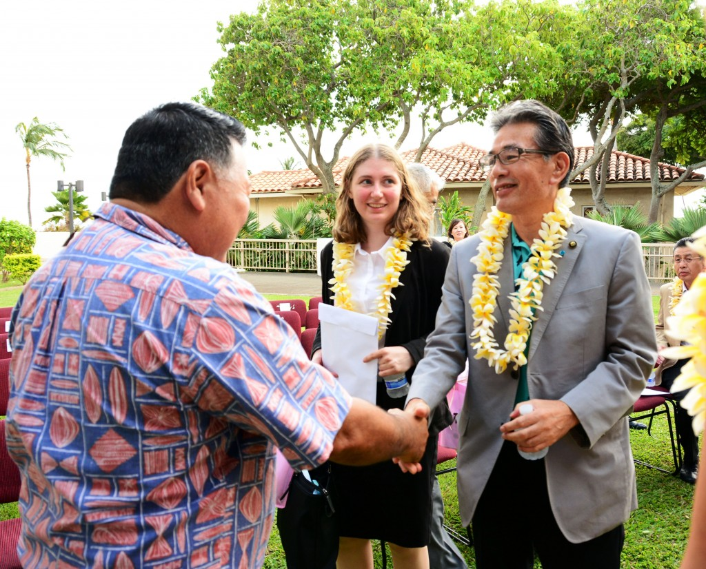 Mayor Alan Arakawa welcomes Fukuyama City Mayor Akira Hada to the County Building on a past visit as Japanese language translator Kathy Rice looks on. Photo credit: Ryan Piros/County of Maui.