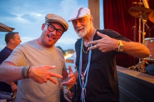 Mick Fleetwood and friend enjoy the rooftop lanai at Fleetwood's on Front Street. Photo by: ©AndrewStuart.com