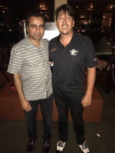 Chief Executive Officer of SSCP Management, Sunil Dharod with Imua Family Services Executive Director Dean Wong, after Dharod matched the tournament's $45K, bringing the night's donation total to $90K.