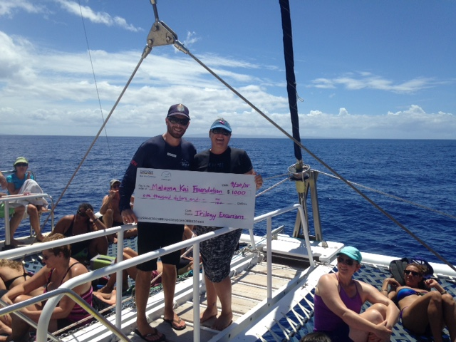 Trilogy donated $1000 to Malama Kai to support their work in maintaining Maui's mooring system and creating future ocean stewards. Photo Credit: Trilogy Excursions.