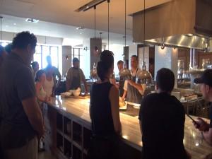 Chef Ben Marquez teaches students in Ka'ana Kupboard Cooking Class. Photo by Kiaora Bohlool.