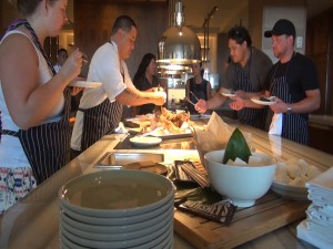 Students eat the food they cooked at Ka'ana Kupboard Cooking Class. Photo by Kiaora Bohlool.