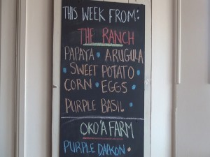The evolving list of farm-fresh produce at Hāna Ranch Provisions in Pāʻia. Photo by Kiaora Bohlool.