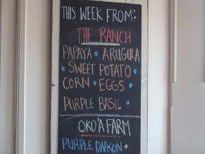 The evolving list of farm-fresh produce at Hāna Ranch Provisions in Pāʻia. Photo by Kiaora Bohlool.