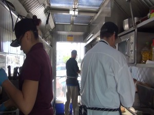 Chefs working in the food truck kitchen at Maui Fresh Streatery. Photo by Kiaora Bohlool.