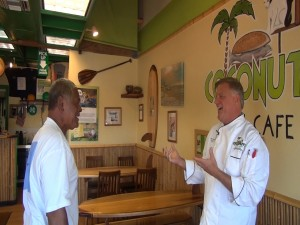 Coconut's Fish Cafe owner Michael Phillips visits with Kumu Kimokeo Kapahulehua, who does the Hawaiian blessings at every Coconut's opening.