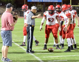 Lahainaluna's Ikaika Viela and the rest of the Lunas' punt team wait for the official's whistle before grounding the ball. Photo by Rodney S. Yap.