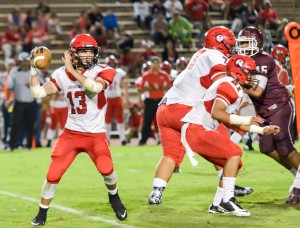 Lahainaluna quarterback Dylan Delatori looks for an open receiver Friday against Baldwin. Photo by Rodney S. Yap.