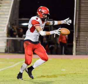 Lahainaluna's Nau Filiai prepares for one of his nine punts through the first three quarters of play. Photo by Rodney S. Yap.