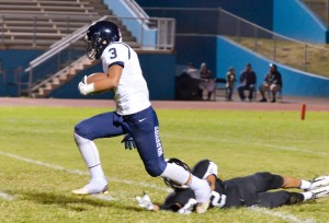 Kamehameha Maui's Ekolu Watanabe fields this punt and looks for running room. Photo by Rodney S. Yap.